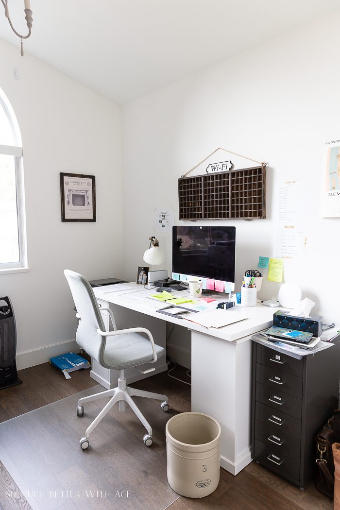 White desk and white walls in office.
