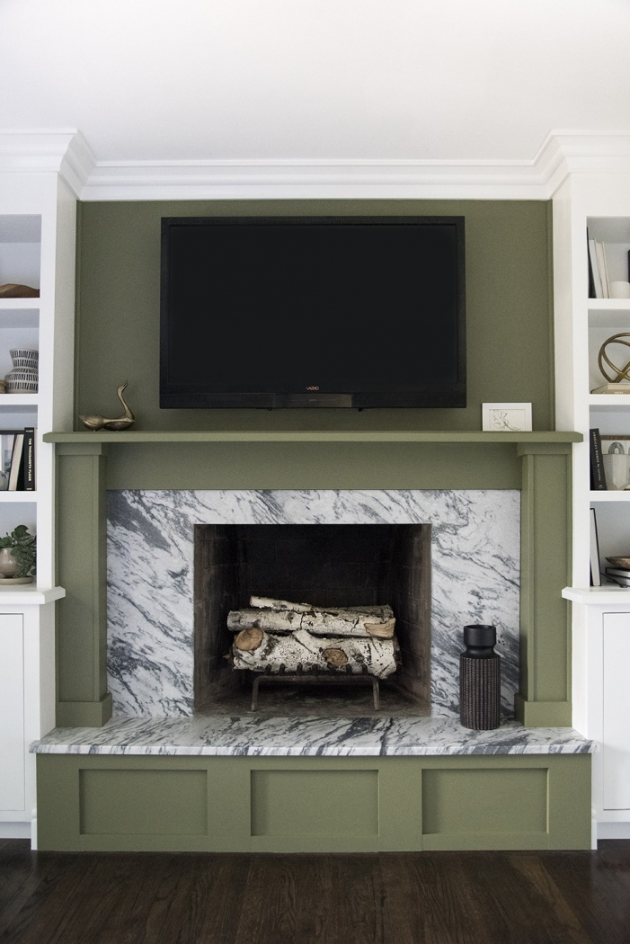 Room for Tuesday - green painted fireplace. Olive Grove by Sherwin Williams.