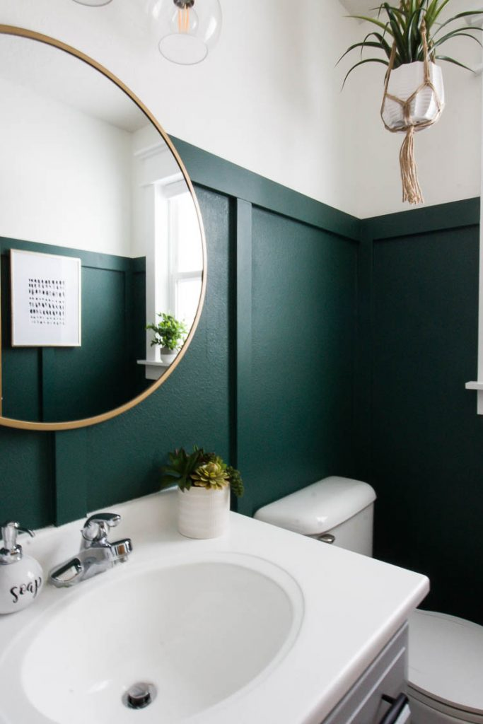 Green painted wall in bathroom by Small Stuff Counts. Rainforest by Behr.