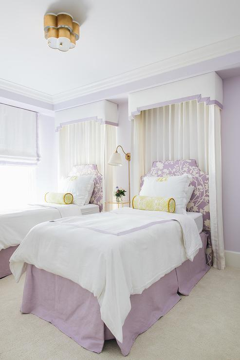 Lilac and yellow girls bedroom with two twin beds from Ash Street Interiors.