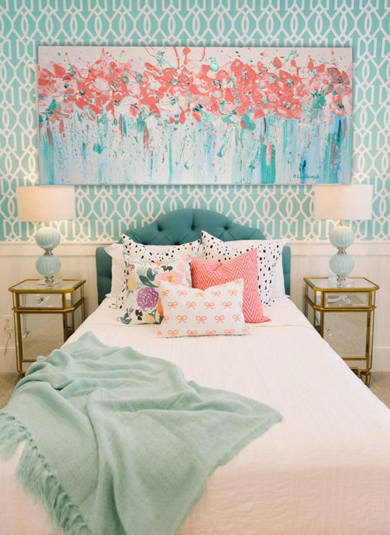 Turquoise accents in bedroom with coral.