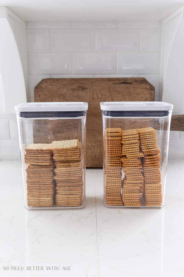 Two clear OXO containers filled with crackers.