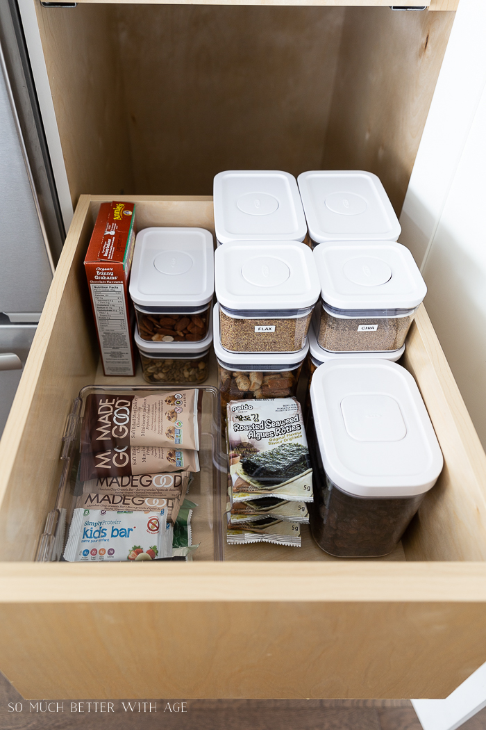 Containers filled with pantry staples in drawer.