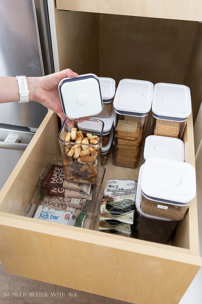 Croutons in acrylic container in kitchen drawer.