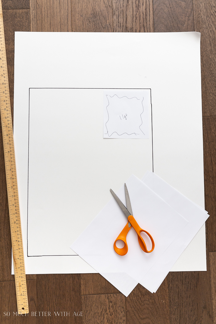 Large rectangle drawn on large white paper with scissors and paper.