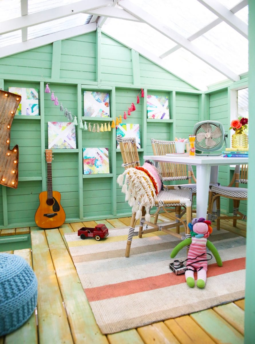 Turquoise / mint walls in play house with coral rug by The Handmade Home.