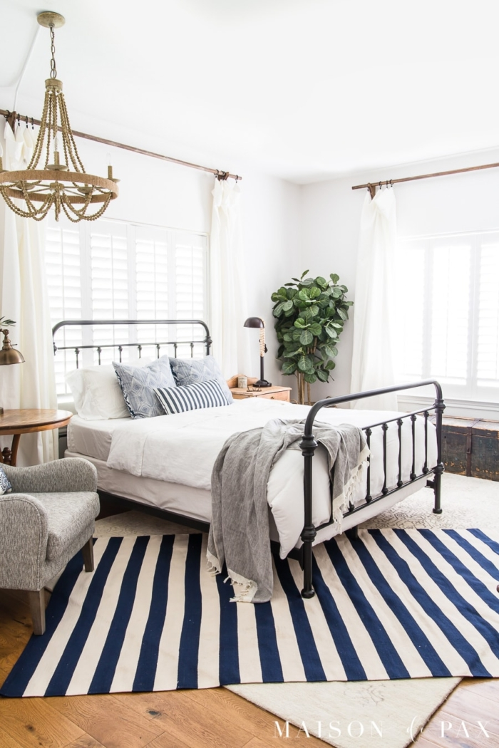 Iron bed and blue and white striped rug from Rachel of Maison de Pax.
