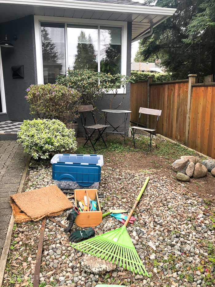 Front yard area with gardening tools.