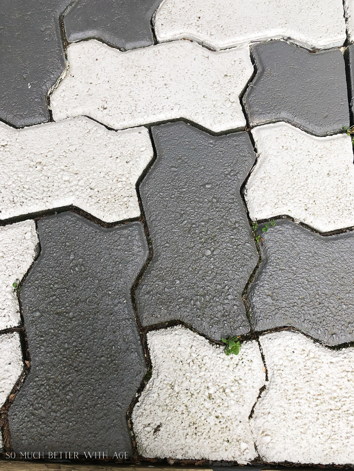 Close-up of painted bricks in grey and white.