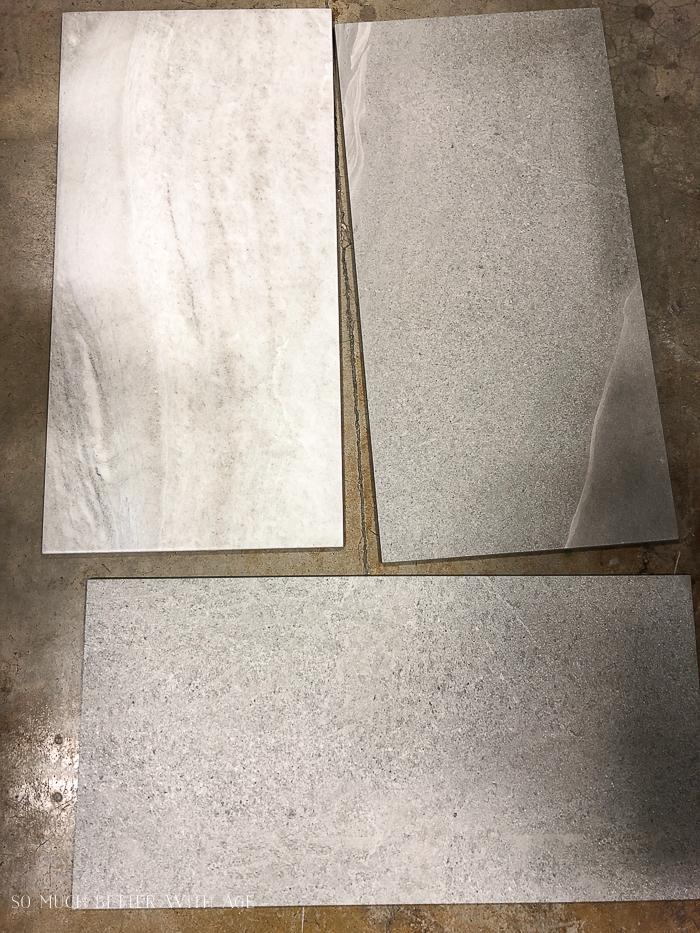Samples of large rectangular tile on floor.
