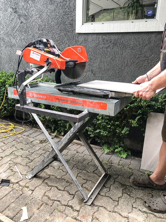 Using a tile saw or wet saw.