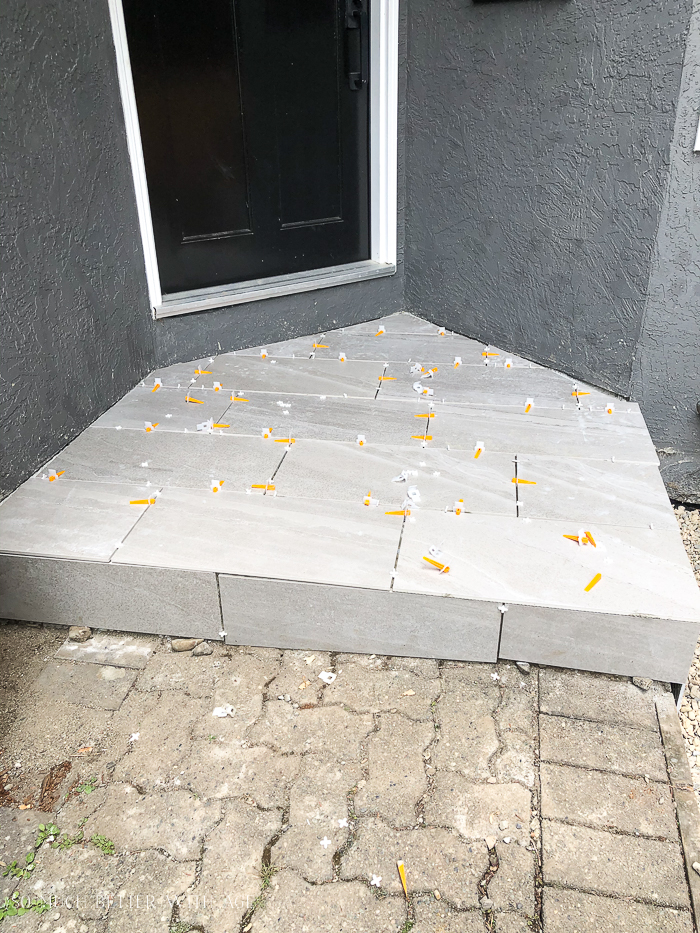Tiles laid out on front step.