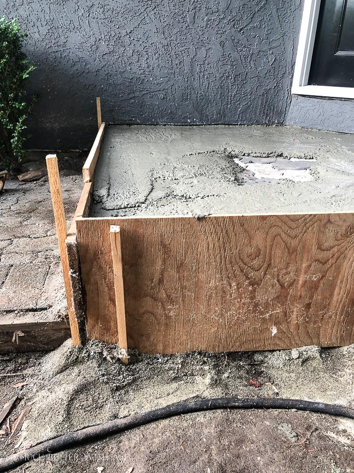 Concrete form set up front of house.