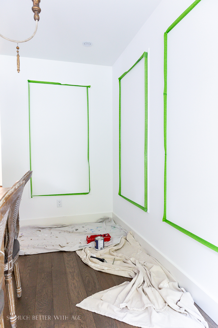 Painter's tape on wall around mouldings.