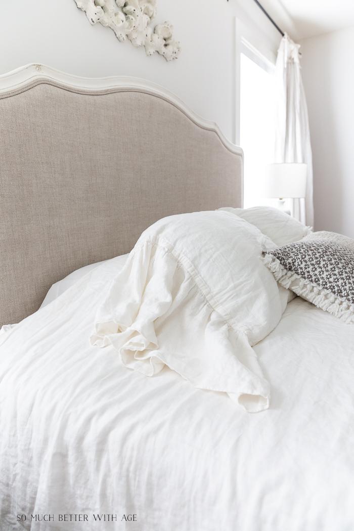 Sham pillows on white duvet.
