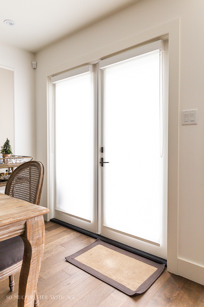 French doors with roller blinds rolled down.