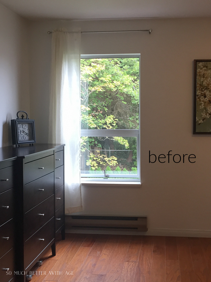 Before photo of bedroom with window and curtains and dresser.