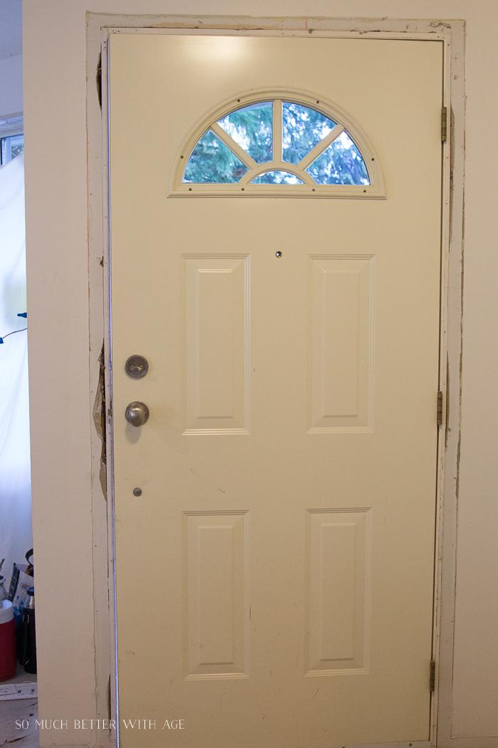Old front door with half moon window at top.