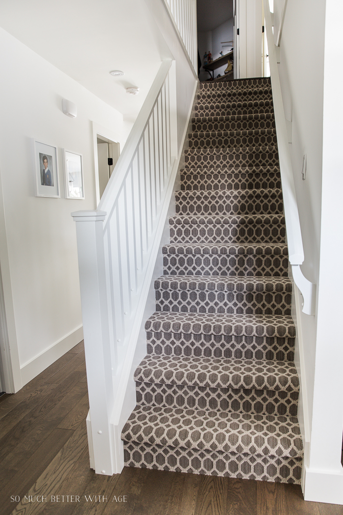 Patterned carpet on stairs.