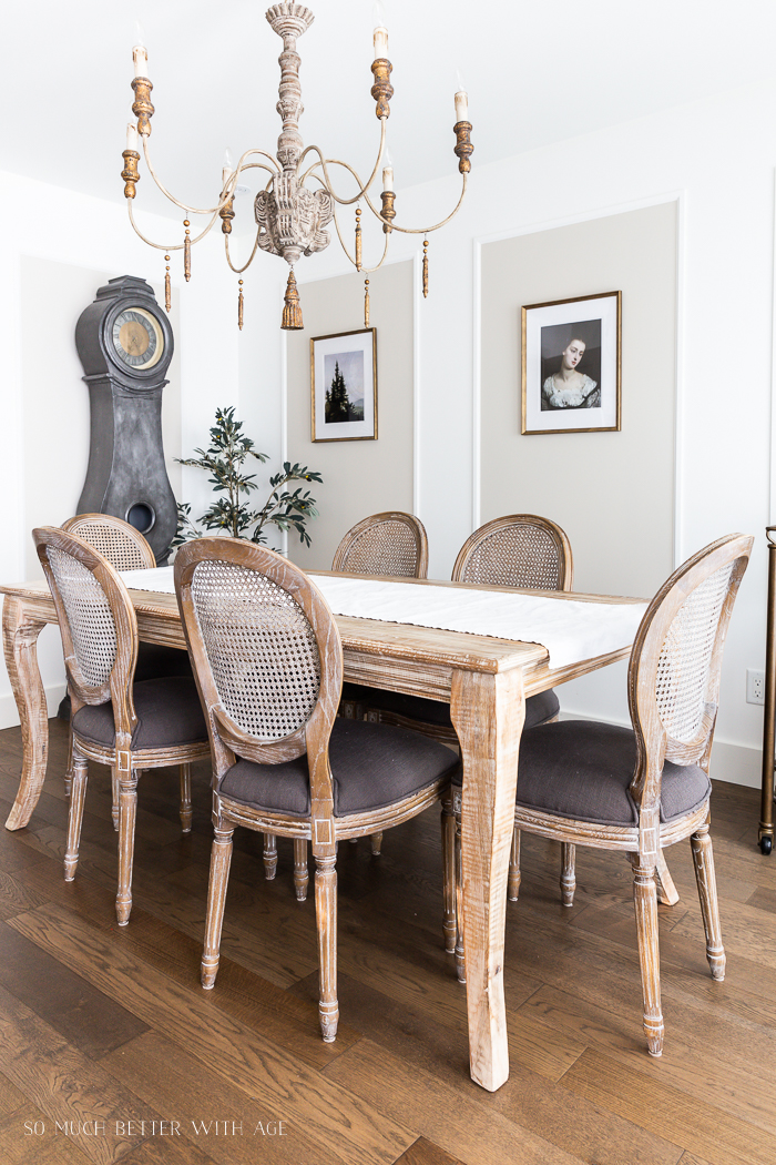 French chandelier in dining room with large Mora clock.