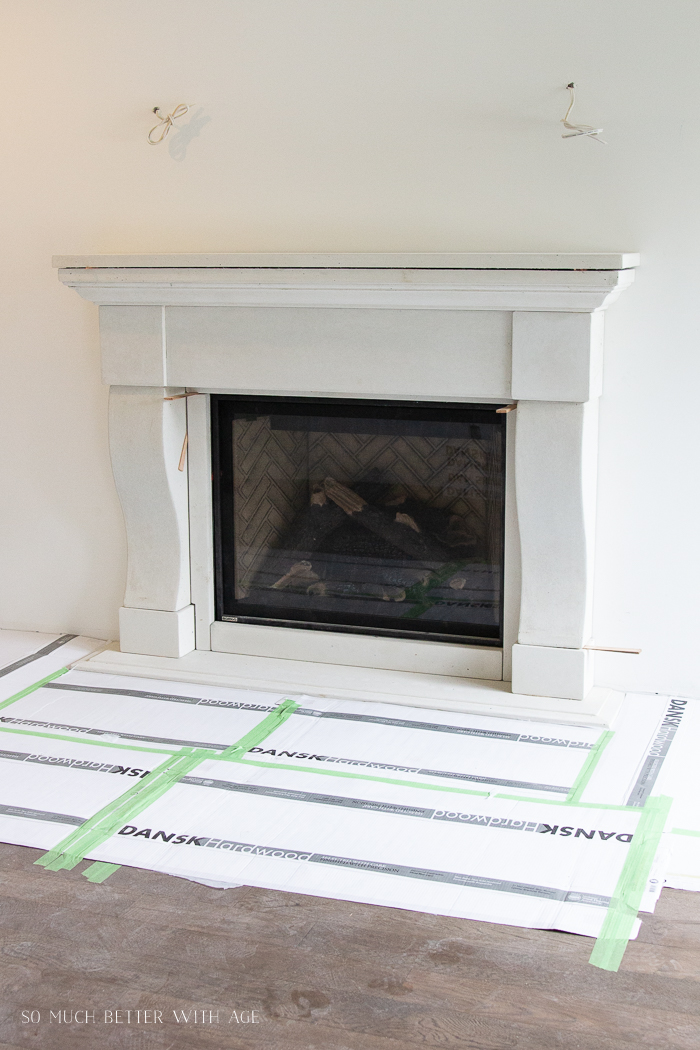 Installation of cast stone fireplace in steps.