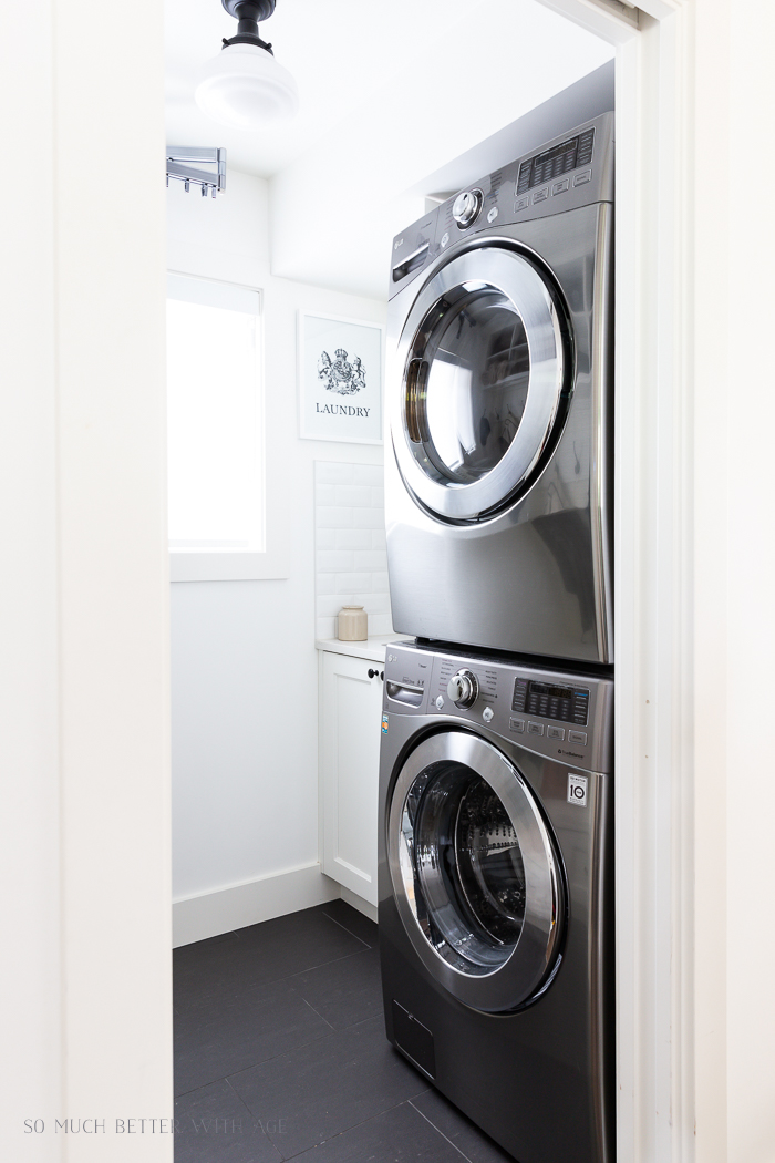 Stacking silver washing machine and dryer.