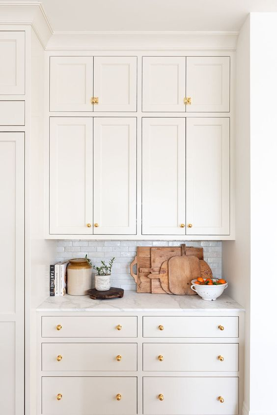 Natural cream painted on kitchen cabinets by Studio McGee.