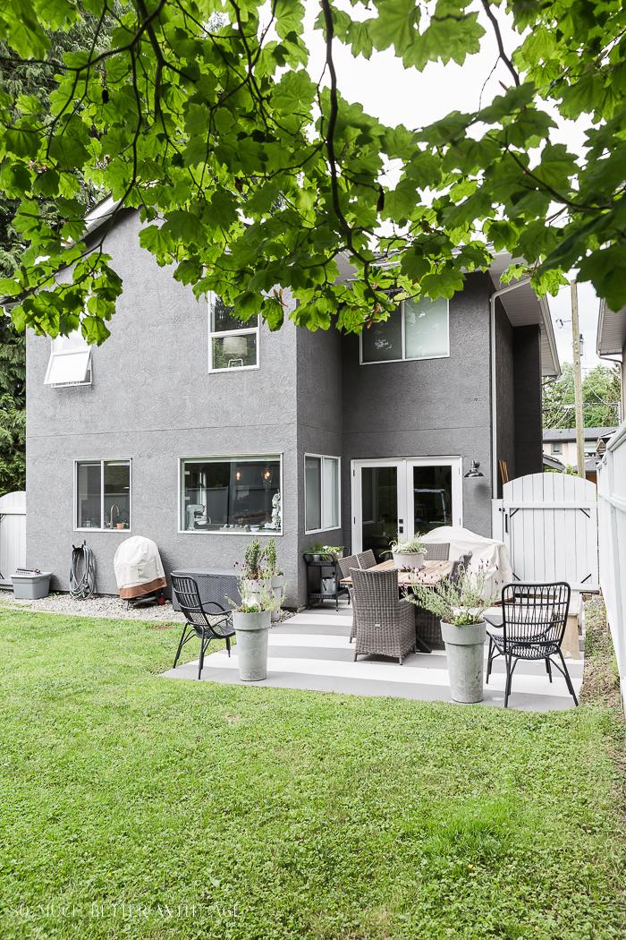Back yard of grey house.