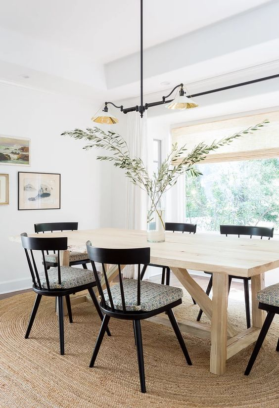 JDP interiors dining room with large oval jute rug.
