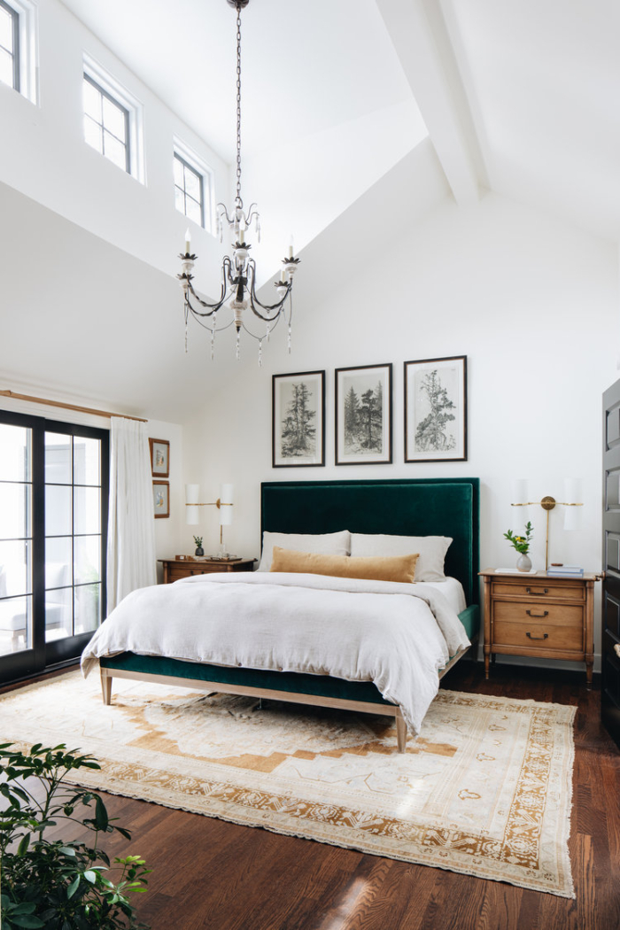 Jean Stoffer Design bedroom with large rug under the bed and vaulted ceiling.
