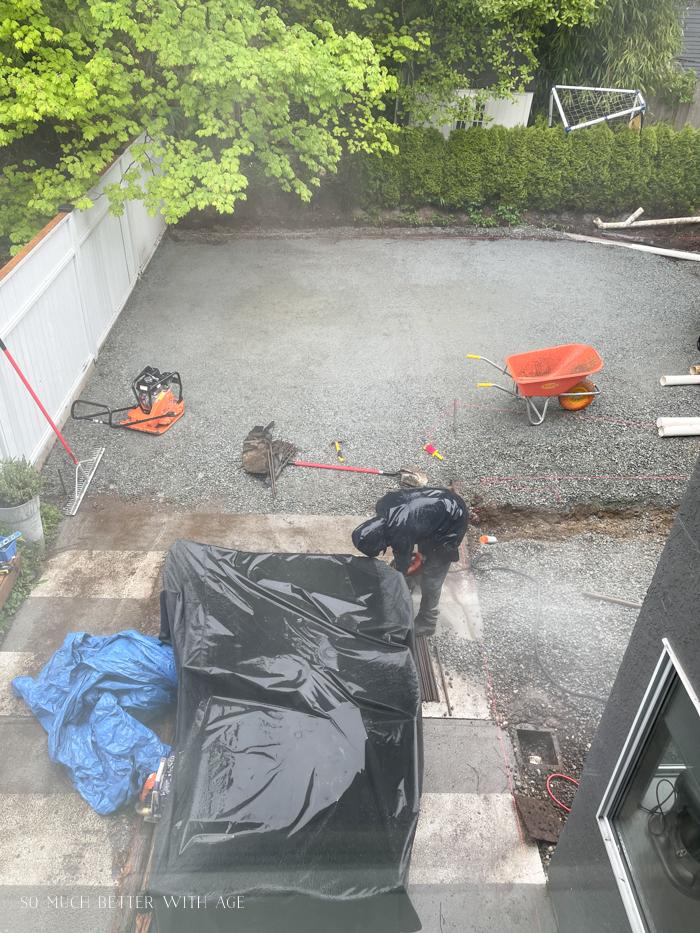 Cutting concrete slab in back yard.