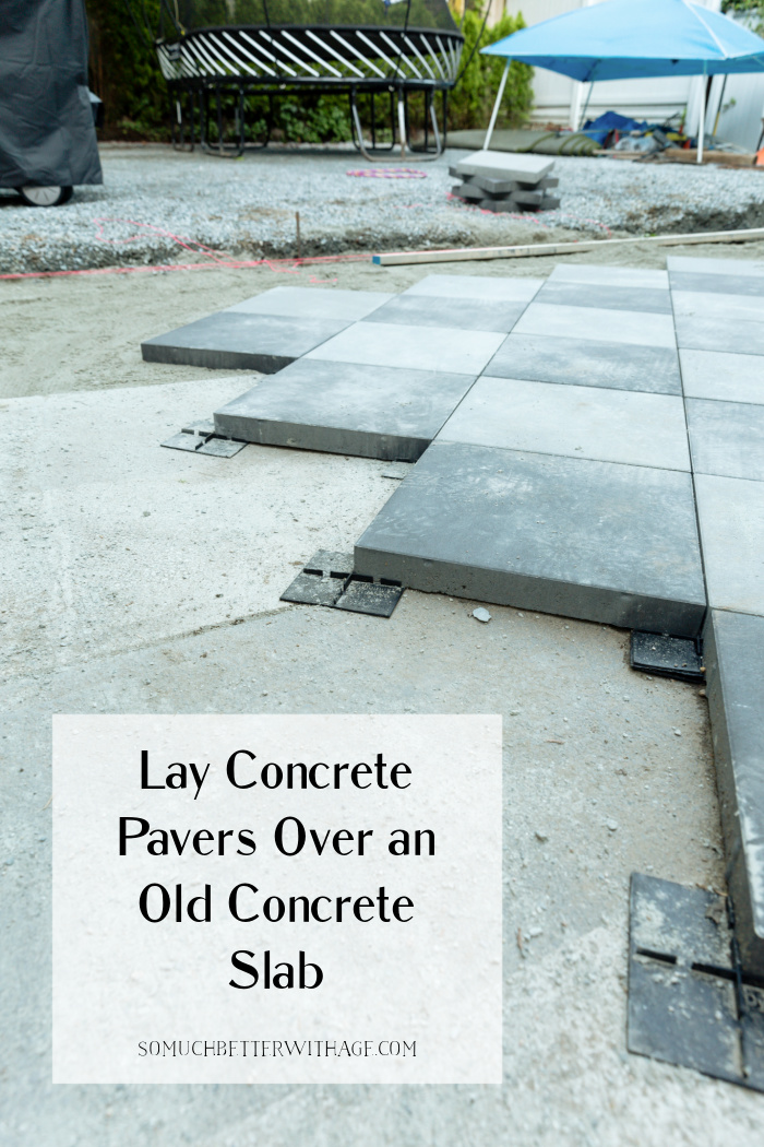 Lay concrete pavers over an old concrete slab.