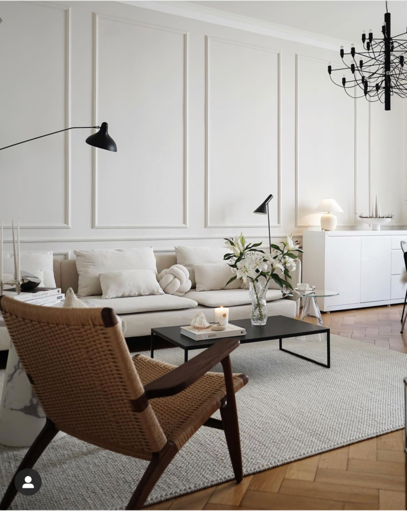 White room with wood floors and chair by Viktoria.