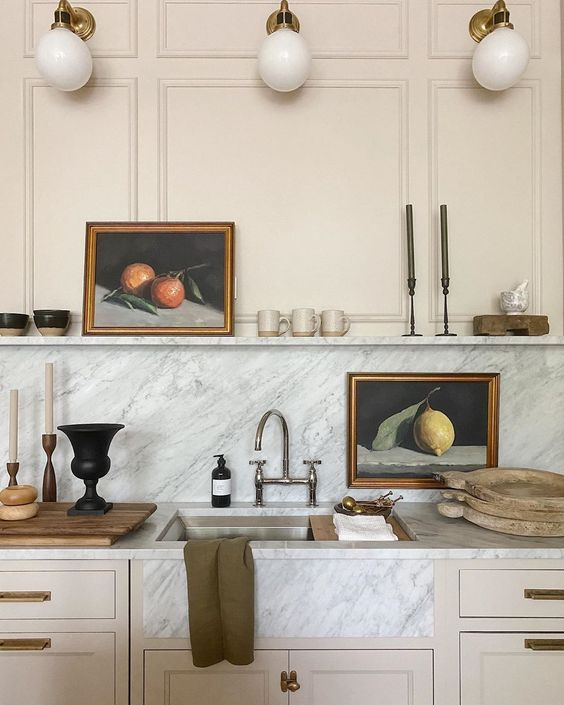 Kitchen with gold light fixtures designed by Jean Stoffer.