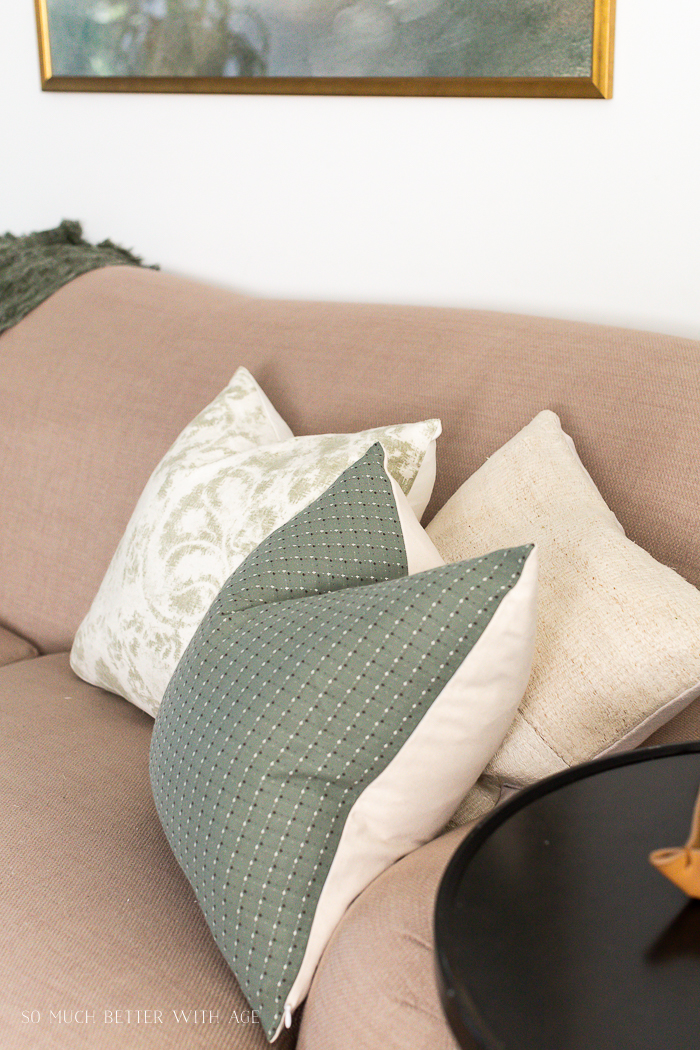 Sage green pillows on sofa.