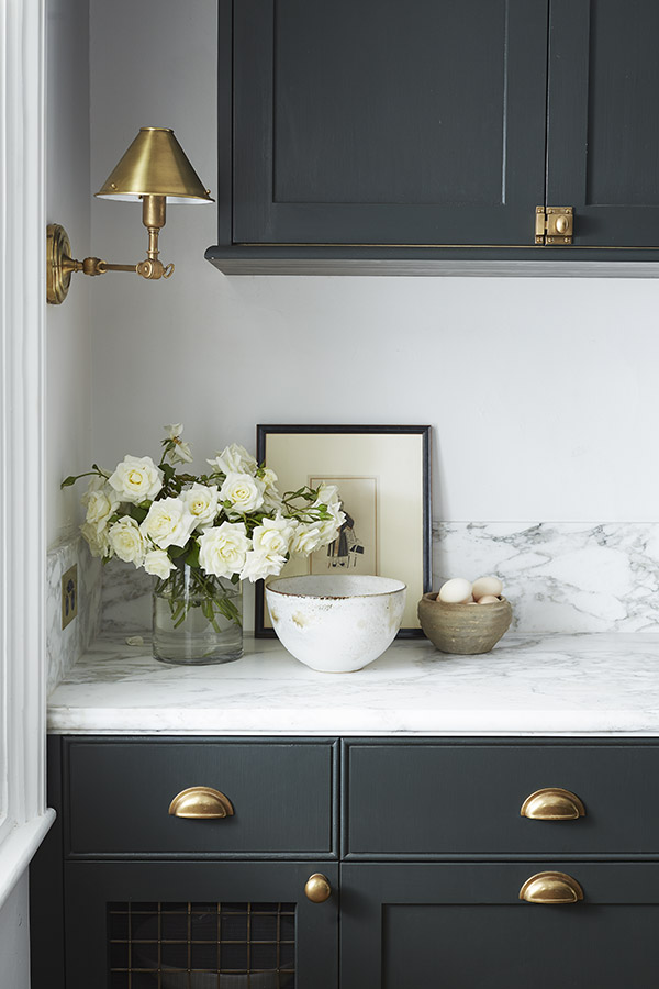 Brass wall sconce in kitchen by Steve Cordony.