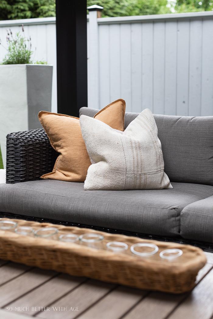 Vintage pillows on outdoor sofa.