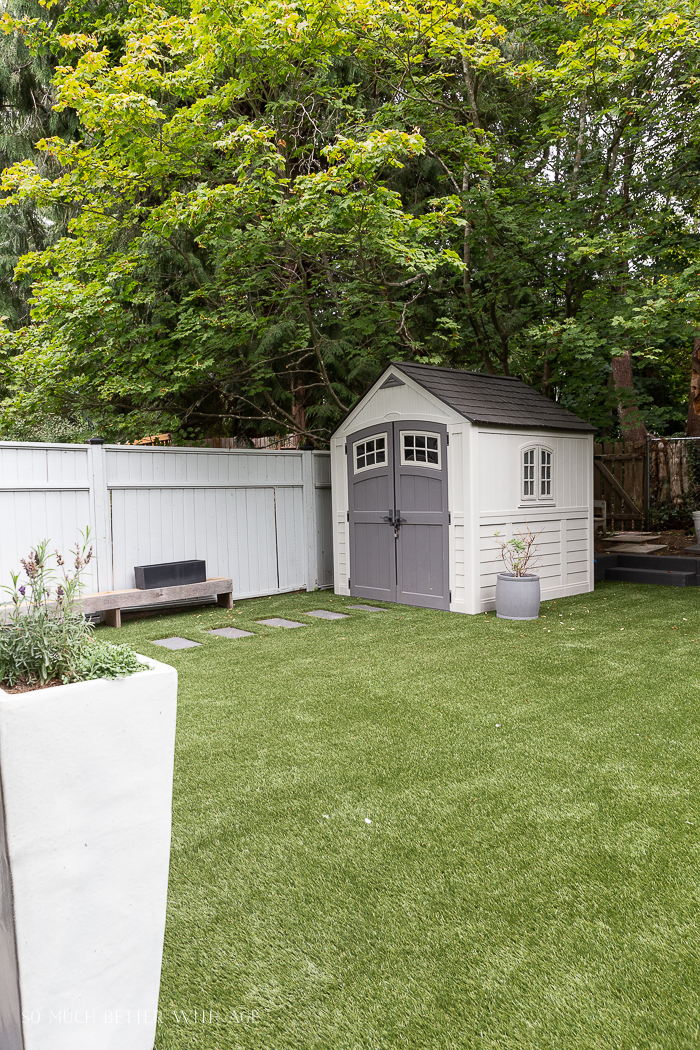 Shad in backyard with artificial turf.