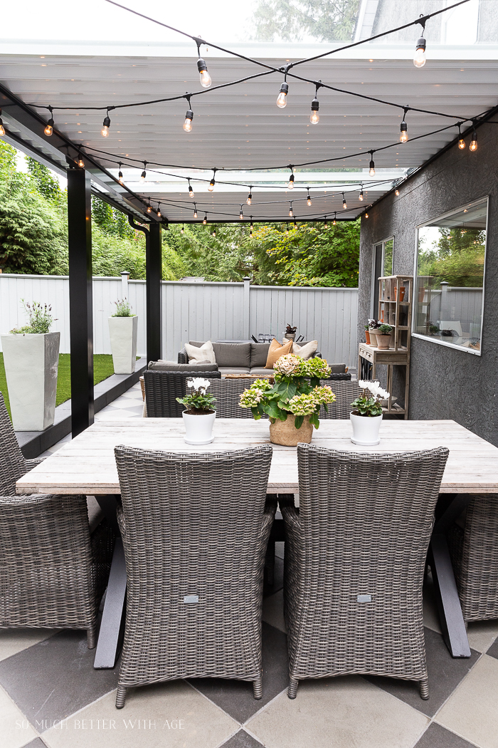 String lights in outdoor patio under covered awning.