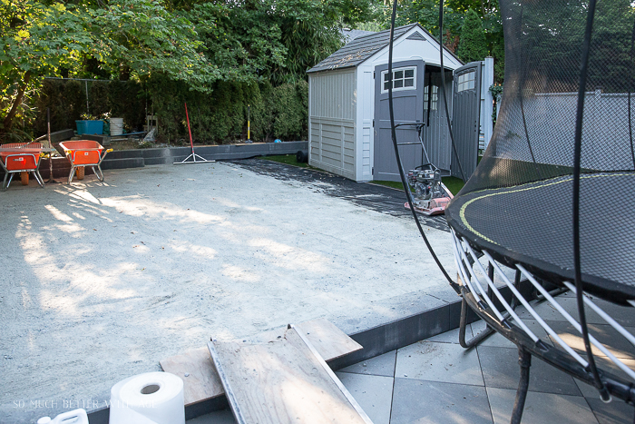 Back yard renovation with sand tampered down.