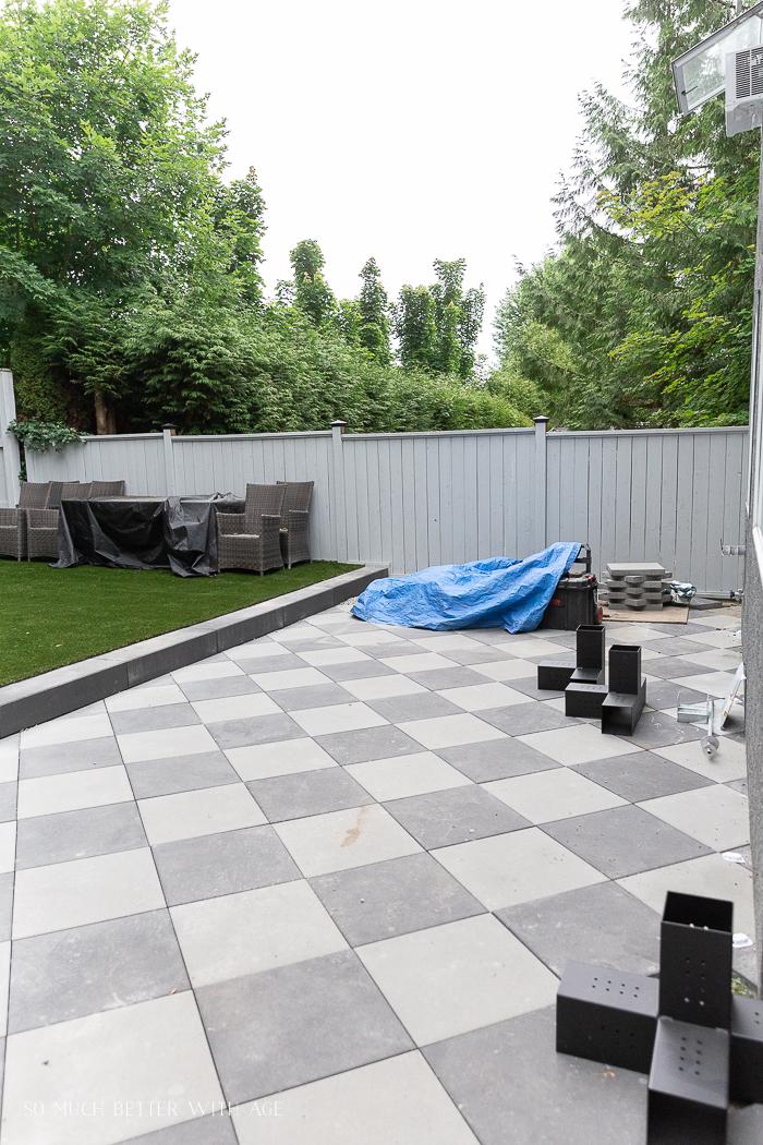 Checkerboard paving stone slabs.