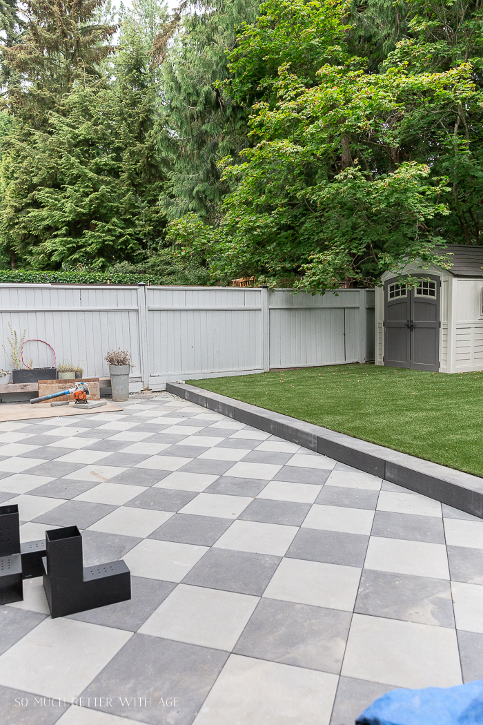 Checkerboard pavers and artificial turf.