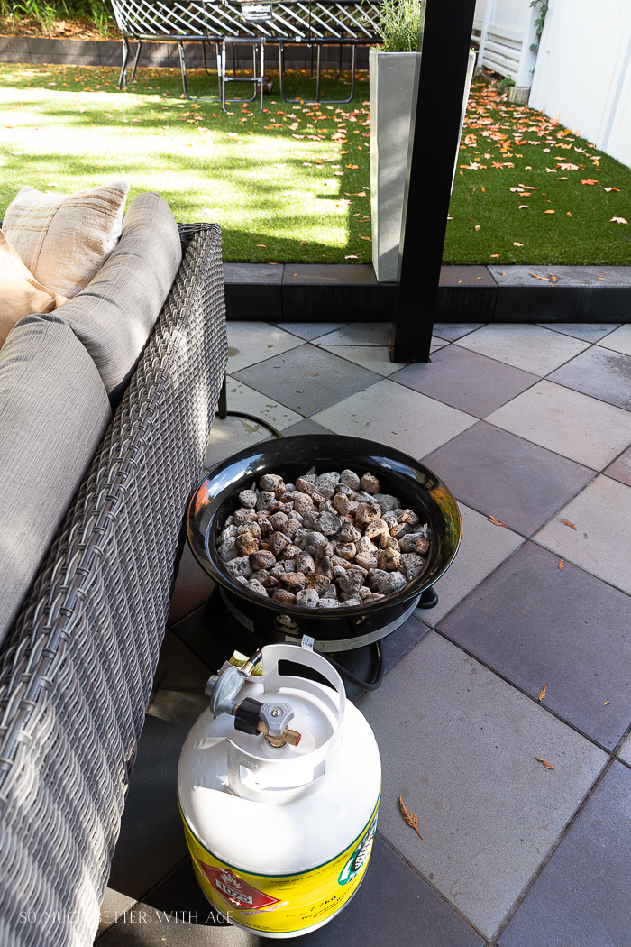 Fire bowl behind outdoor sofa.
