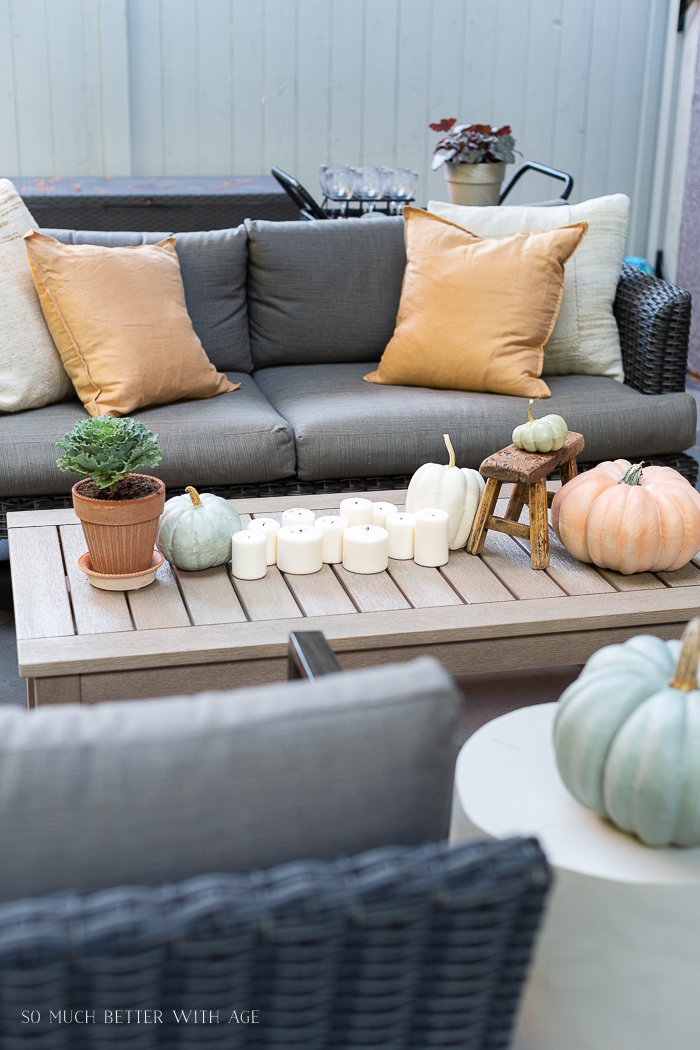 Fall pumpkins decorated in outdoor seating area.